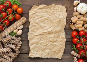 Pasta, garlic, herbs and tomatoes photo