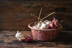 garlics and red onions in the basket