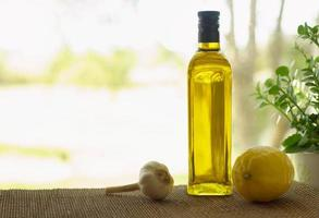 Olive oil bottle with garlic and lemon