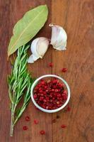 pink pepper with garlic and rosemary