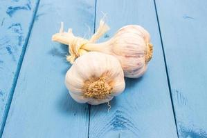Fresh garlic on a blue board photo