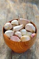 garlic in a wooden bowl photo