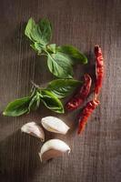 Chili with garlic and basil leaf
