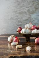 Garlic and onions in a brass tray.