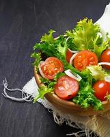 Fresh salad with tomato, frisee and onion