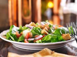 salad with lettuce, tomato and croutons photo