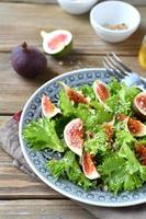 Delicious salad with figs and lettuce photo