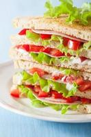 sandwich with ham tomato and lettuce photo