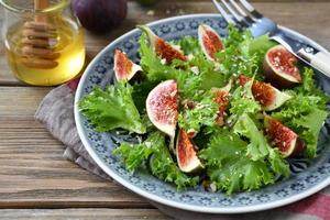 Light salad with figs, lettuce and honey photo