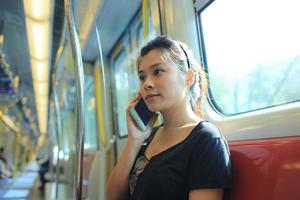 Girl  pick up a phone call photo