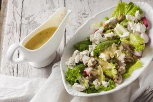Delicious vegetable salad with cheese and mushrooms photo