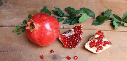 Pomegranate ripe juicy fruits on the wooden table