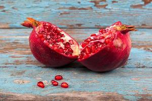 Fresh pomegranate on wooden boards.
