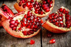 ruby pomegranate grains closeup on a table