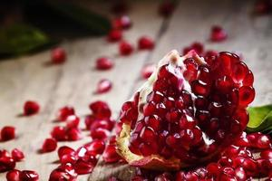 Fresh peeled pomegranates with ruby red seeds