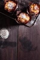 Muffins on wooden background.
