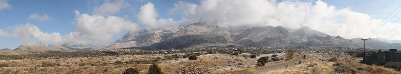sandia mountains in winter clouds panorama