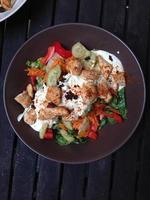 Mixed salad on wooden table photo