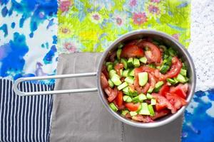 salad of tomatoes and cucumbers photo