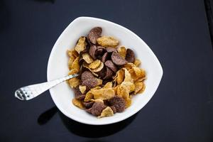 Cornflakes in a bowl on the table. photo