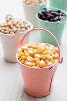 Bulk of corn grain on wooden table, macrobiotic food