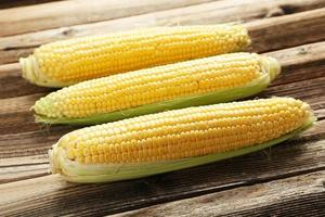 Corns on a brown wooden background photo