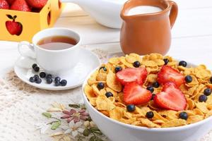 Breakfast - cornflakes with  strawberries and blueberries photo