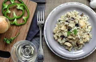 Risotto with mushrooms and chicken photo