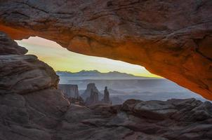 Looking threw Mesa Arch Utah.
