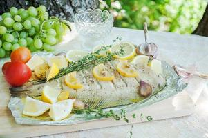 Lunch with fish flounder in Mediterranean style outdoors
