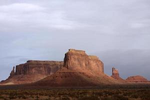 Monument Valley buttes with gray sky background photo