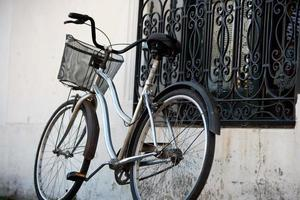 Vintage Chromed Bicycle with Basket Next to a House Window
