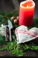 Cutlery accompanied with candle and hearts fabric