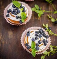 muffins with blueberries, cream and fresh berries photo