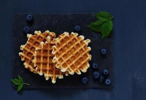Viennese waffles with blueberries.