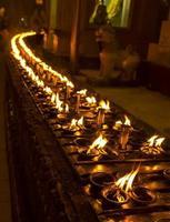 Candles lit at Shwedagon pagoda photo