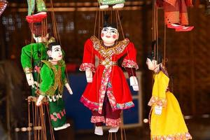 Traditional handicraft puppets are sold in a shop in Myanmar