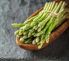 Bunch of fresh asparagus on table