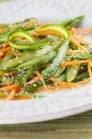 Asparagus salad with carrot and hemp seeds