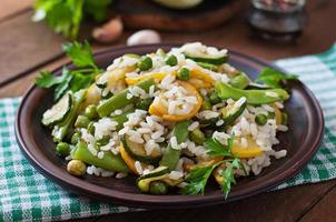 Risotto with asparagus beans, zucchini and green peas