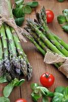 organic asparagus on wooden table photo