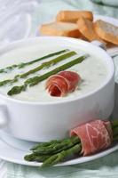 Asparagus cream soup with ham vertical