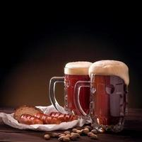 Mugs of beer with snacks