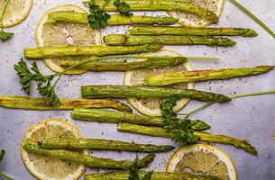 Grilled asparagus with lemon and parsley photo