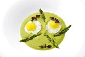 Dish of asparagus pureed quail eggs