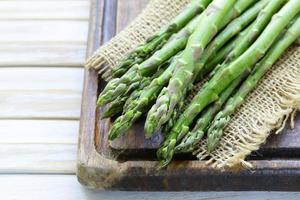 fresh green organic asparagus on a wooden background photo