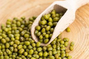 Mung beans over wooden spoon photo