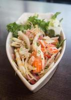 Thai spicy seafood salad on the plate photo