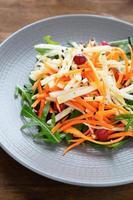 carrots, celery, cabbage salad with arugula photo
