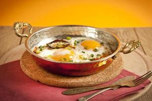 Turkish sausage sucuk with egg in copper pan turkish breakfast